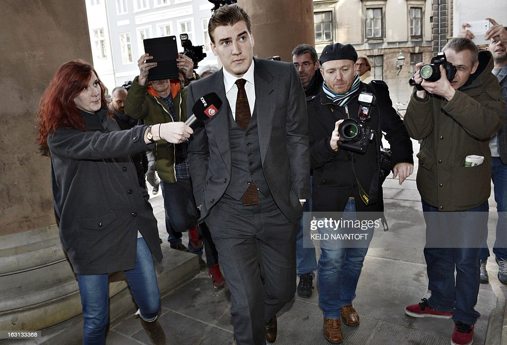 Journalists and photographers surround Danish football player Nicklas Bendtner (C) as he arrives at the Copenhagen City Court on March 5, 2013 in Copenhagen, Denmark for drunk driving. Nicklas Bendtner was given a fine of 113.000 Euros and deprived of his license for 3 years. The Danish football Federation (DBU) has suspended striker Nicklas Bendtner from international football for six months because of his arrest for drink driving, they announced on Monday, March 4, 2013.