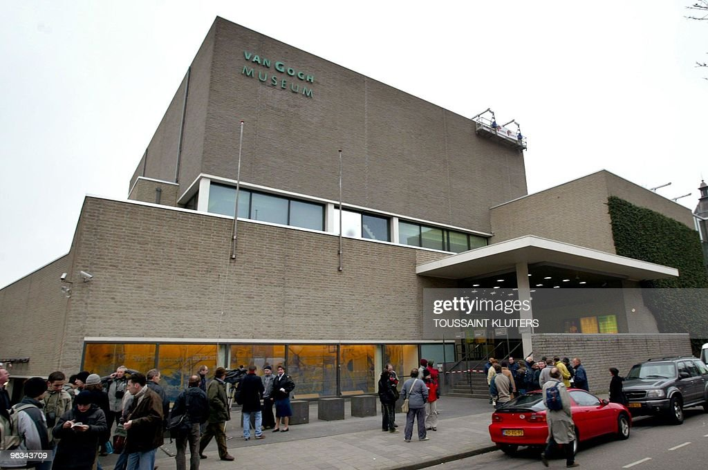 Journalists and tourists gather outside the closed Van Gogh museum in Amsterdam 07 December 2002 Two paintings of the famous Dutch impressionist...