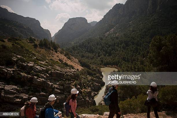 Journalists and visitors admire the scenery during a visit to the footpath 'El Caminito del Rey' a narrow walkway hanging and carved on the steep...