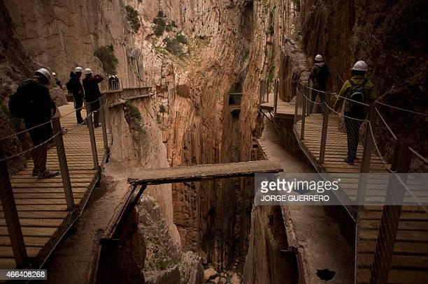 Journalists and visitors walk during a visit to the footpath 'El Caminito del Rey' a narrow walkway hanging and carved on the steep walls of a defile...
