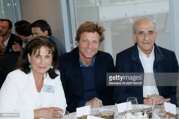 Journalists Anne Sinclair Laurent Delahousse and JeanPierre Elkabbach attend the 'France Television' Lunch during the 2017 French Tennis Open Day Ten...