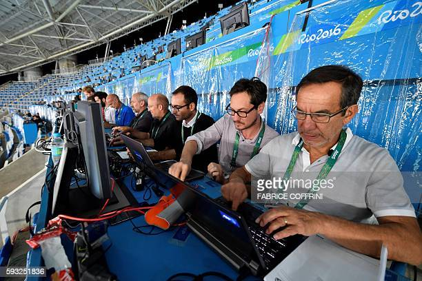 AFP journalists are at work in the tribune of the Olympic stadium during the athletics event at the Rio 2016 Olympic Games in Rio de Janeiro on...