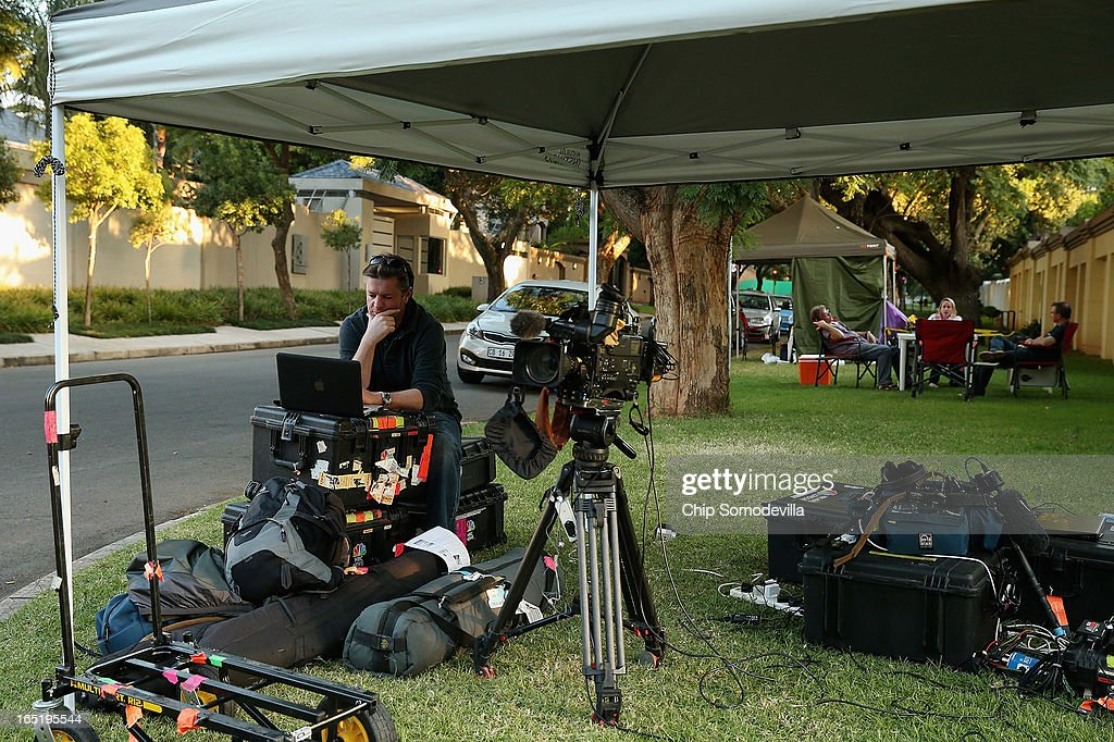 Journalists are camped out across the street from former South Africa President Nelson Mandela's home April 1, 2013 in Johannesburg, South Africa. Mandela, 94, is recovering from pneumonia in hospital, his third stay in the last four months. Mandela's lungs were damaged when he contracted tuberculosis during his 27 years in the infamous Robben Island prison. Mandela became the nation's first democratically elected president in 1994 following the end of apartheid.