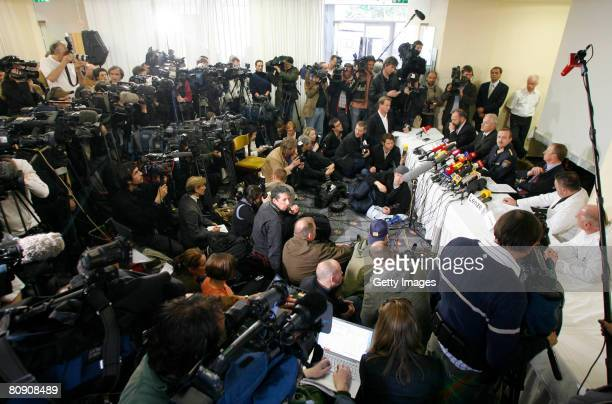 Journalists are seen during a press conference at the Stadthotel Guertler over the case of 24 yearlong capture and incestuous abuse of woman by her...