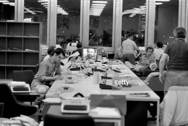 Journalists are seen working in August 1972 at the AFP desk installed at the 1972 Munich Summer Olympics press center AFP PHOTO