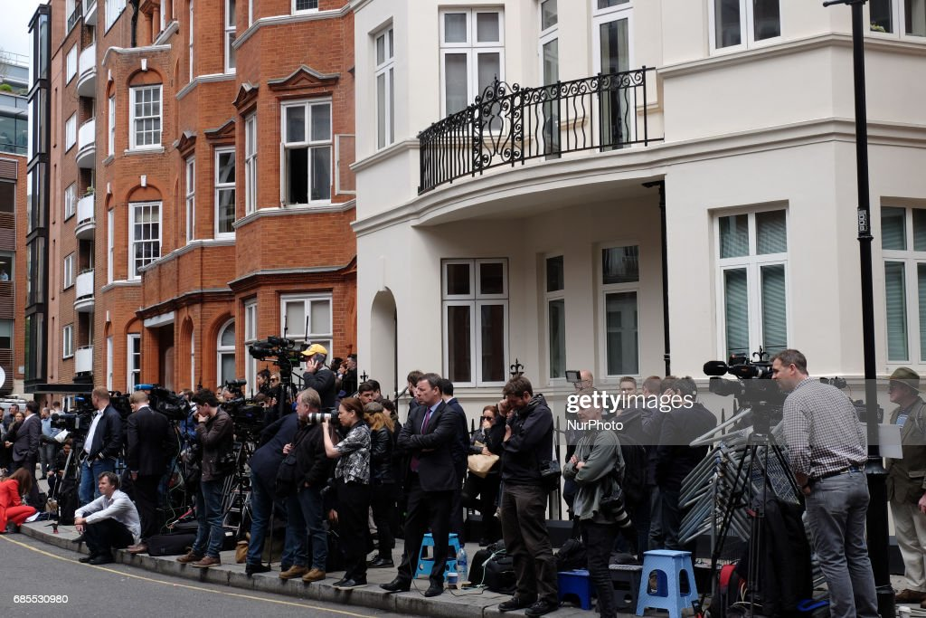 Journalists at the Ecuadorian embassy as people wait for Julian Assange to come out and make a statement, in London, on May 19, 2017.