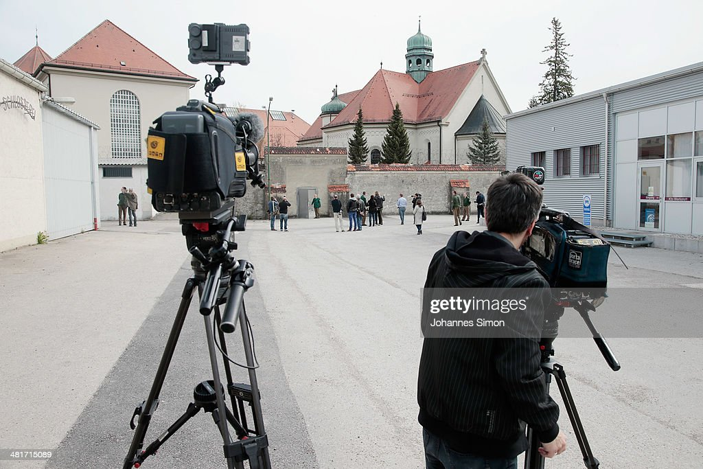 Journalists attend a guided tour at the Landsberg prison, where former FC Bayern Muenchen president Uli Hoeness will serve his three-year sentence on March 31, 2014 in Landsberg, Germany. A judge found Hoeness guilty of evading taxes totaling at least EUR 27.2 million and declared his pre-emptive attempt at turning himself in to German tax authorities as invalid. Hoeness has been a pillar in German football club history, beginning with his career as a stellar professional player with FC Bayern in the 1970s to his role as FC Bayern club chairman, during which the Bundesliga team has been among the most successful in Germany.