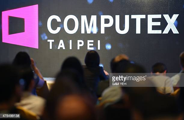 Journalists attend a press conference ahead of the Computex tech trade show at the World Trade Center in Taipei on June 1 2015 Smart living and...