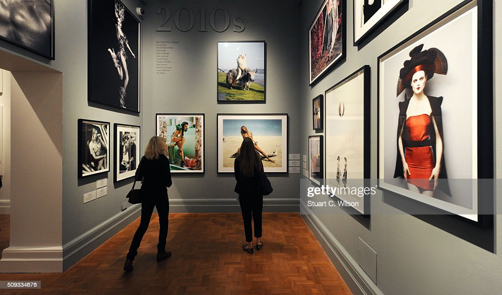 Journalists attend the press preview for 'Vogue 100: A Century of Style' exhibiting the photographs that has been commissioned by British Vogue since it was founded in 1916 at National Portrait Gallery on February 10, 2016 in London, England.
