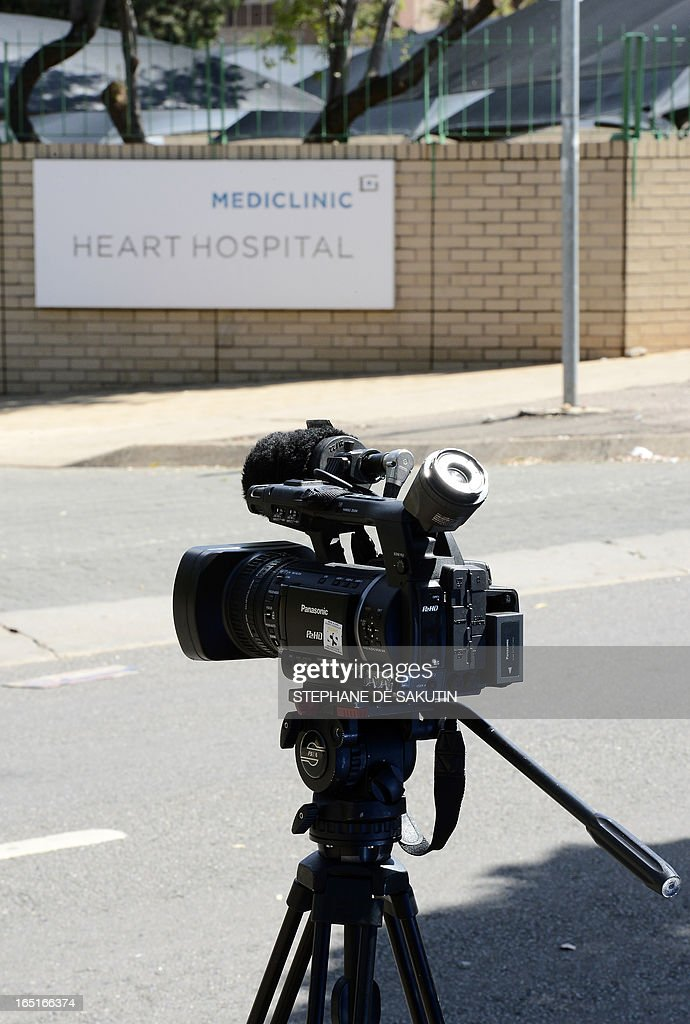 A journalist's camera is set up outside the Mediclinic Heart Hospital on April 1, 2013 in Pretoria where former South African President Nelson Mandela is possibly hospitalized. Nelson Mandela's condition has improved further, the South African government said as the ailing anti-apartheid icon spent his fifth day in hospital on April 1 receiving treatment for a recurrence of pneumonia.
