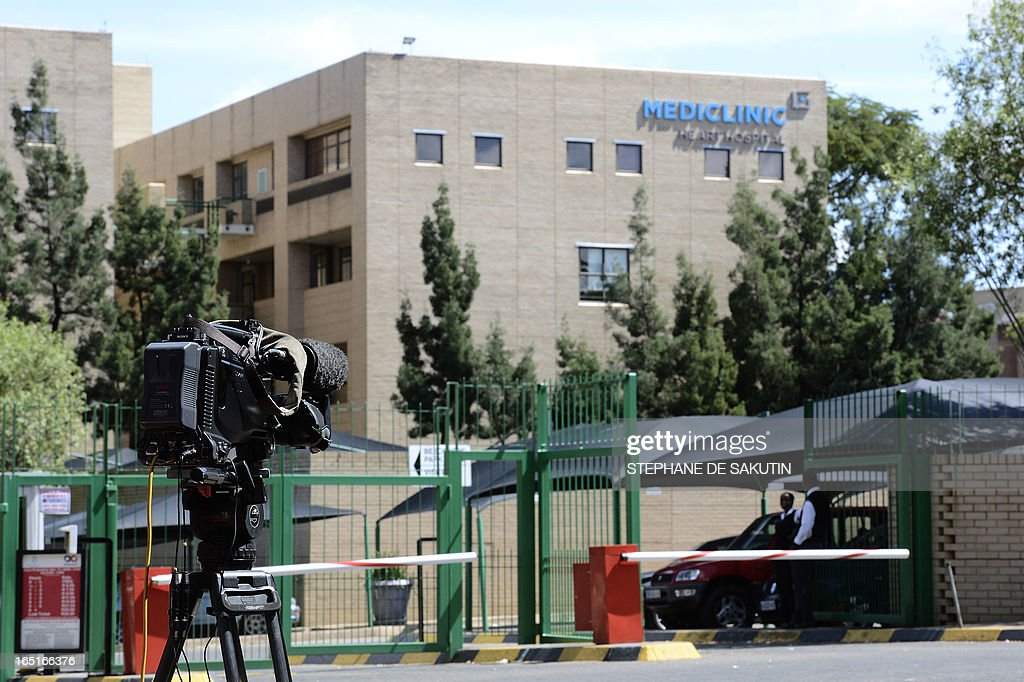 A journalist's camera is set up outside the Mediclinic Heart Hospital on April 1, 2013 in Pretoria where former South African President Nelson Mandela is possibly hospitalized. Nelson Mandela's condition has improved further, the South African government said as the ailing anti-apartheid icon spent his fifth day in hospital on April 1 receiving treatment for a recurrence of pneumonia. AFP PHOTO / STEPHANE DE SAKUTIN