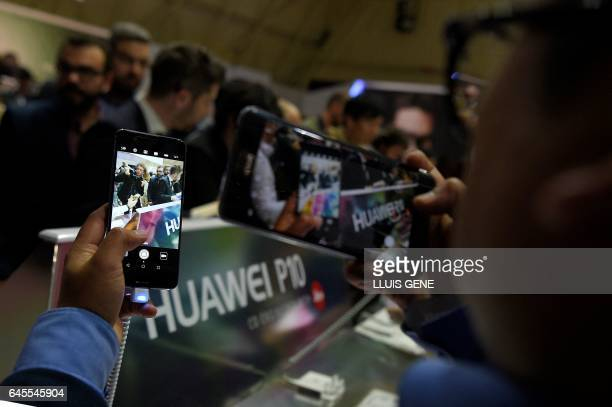 Journalists check the new model of Chinese multinational networking and telecommunications equipment and services company Huawei the Huawei phone P10...