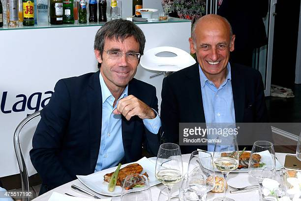 Journalists David Pujadas and JeanMichel Apathie attend the 2015 Roland Garros French Tennis Open Day Nine on June 1 2015 in Paris France