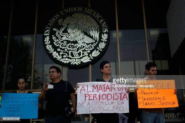 Journalists display signs during a demonstration after the Mexican journalist Javier Valdez murder at the Attorney General's Office of Jalisco on May...