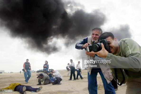 Journalists document a Civil Defense Authority mock chemical attack December 28 2002 in Kuwait City Kuwait The Civil Defense Center continues to...