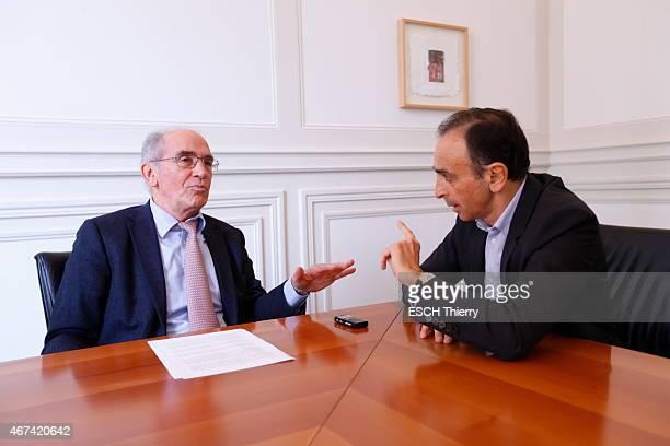 Journalists Eric Zemmour and Francois de Closets pose in Paris on March 11 2015