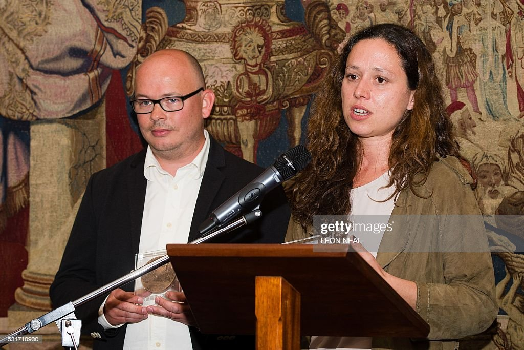 Journalists Etienne Huver (L) and Sophie Nivelle-Cardinale address guests after being jointly awarded the Prix Albert Londres at the French Ambassador's residence in west London, on May 27, 2016. A series of reports from Africa and a film about the war in Syria were awarded the Prix Albert Londres for francophone journalists on Friday, as organisers drew attention to the need to protect whistle-blowers. / AFP / LEON