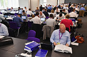 Journalists examine The Iraq Inquiry Report at the Queen Elizabeth II Centre in Westminster on July 6 2016 in London England The Iraq Inquiry Report...