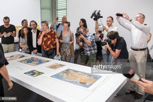 Journalists film take picture and look at the pieces of a art during the press preview of the first masterpieces of the estate of German collector...
