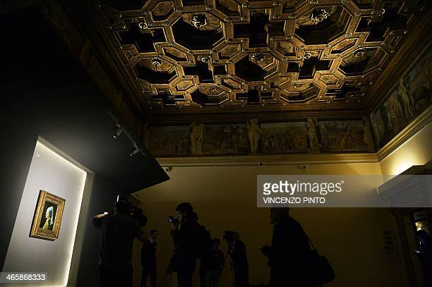 Journalists film the painting by Johannes Vermeer entitled 'the Girl with a Pearl Earring ' during a preview of the exhibition ' The Myth of the...