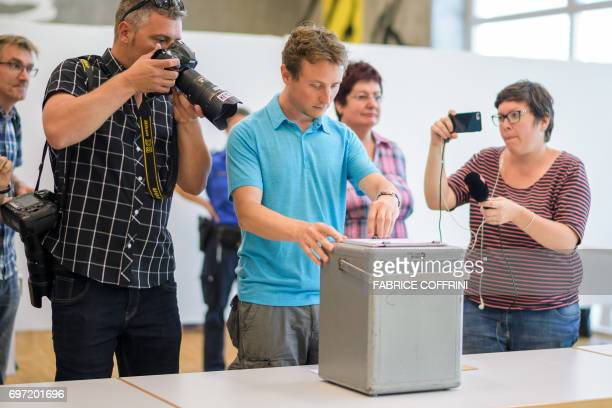 Journalists films the closing of the ballot box during an historical anticipated vote on June 18 2017 in Moutier northern Switzerland Moutier vote...