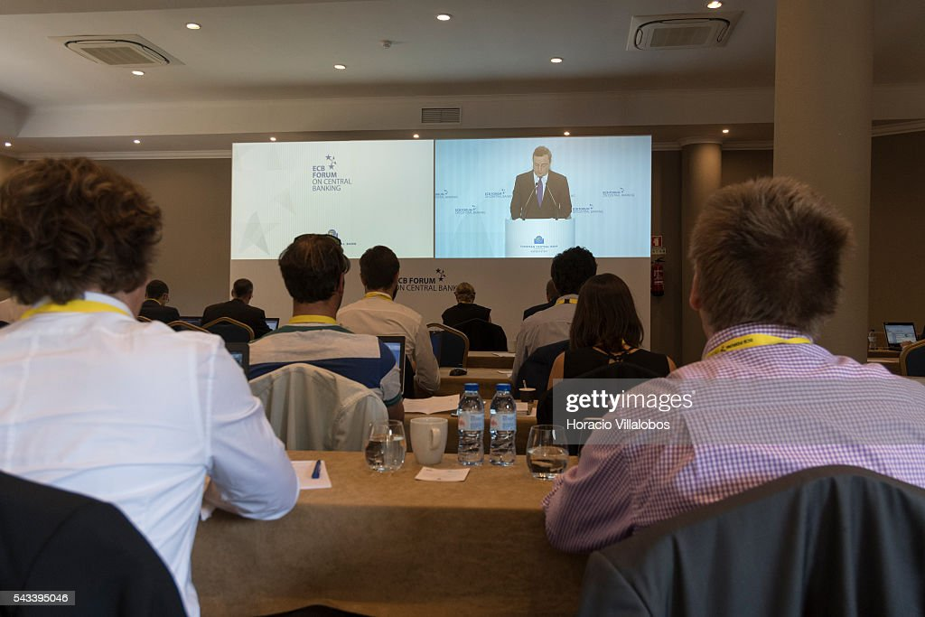 Journalists follow from a screen at the pressroom ECB President Mario Draghi's introductory speech in the ECB Forum on Central Banking on June 28, 2016 in Sintra, Portugal. The third annual European Central Bank Forum on Central Banking focuses on 'The future of the international monetary and financial architecture', a key topic of debate among economists and policymakers. Some 150 central bank governors, academics, financial journalists and high-level financial market representatives will discuss current policy issues and the chosen topic from a longer-term perspective.