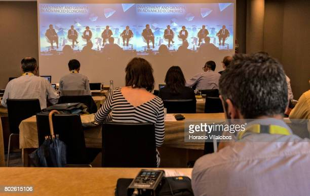 Journalists follow from the pressroom the video projection of the last panel discussion on the last day of the ECB Forum on Central Banking on June...
