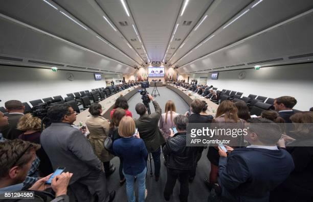 Journalists follow the Organization of the Petroleum Exporting Countries meeting in Vienna on September 22 2017 where the OPEC members reviewed...