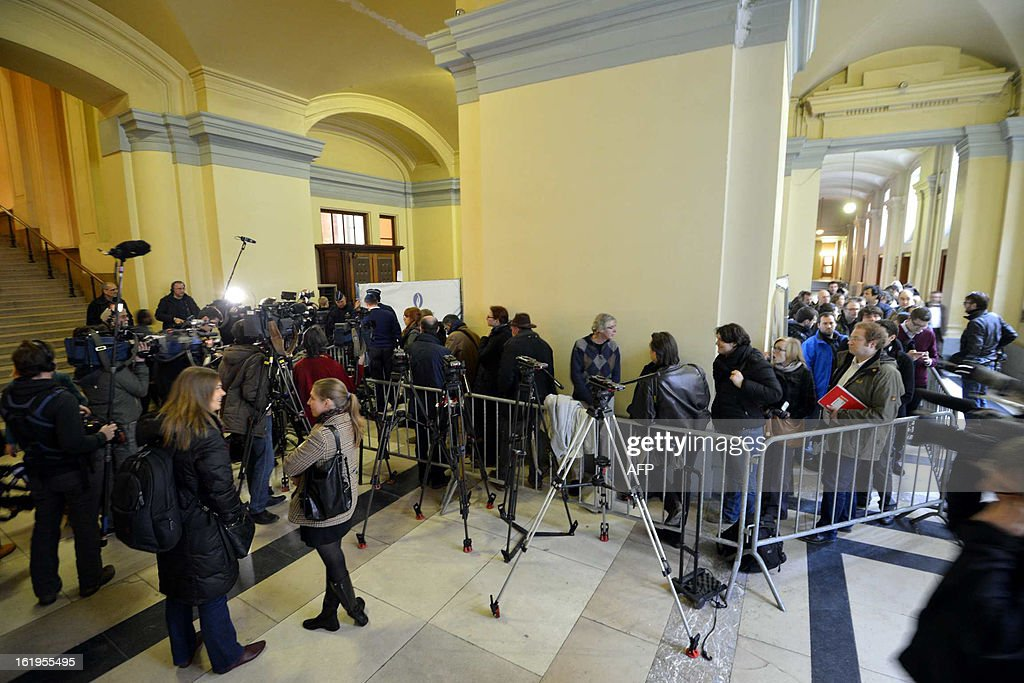 Journalists gather after an appearance of notorious Belgian paedophile killer Marc Dutroux on February 18, 2013 at the courthouse in Brussels. A Belgian court on February 18 turned down a request by notorious child sex killer Marc Dutroux for early release from prison to serve out the rest of his sentence at home under electronic surveillance. The ruling against Belgium's 'most hated man,' cited the risk he might offend again after being jailed for life in 2004 for the kidnap and rape between June 1995 and August 1996 of six young and teenage girls, four of whom died.