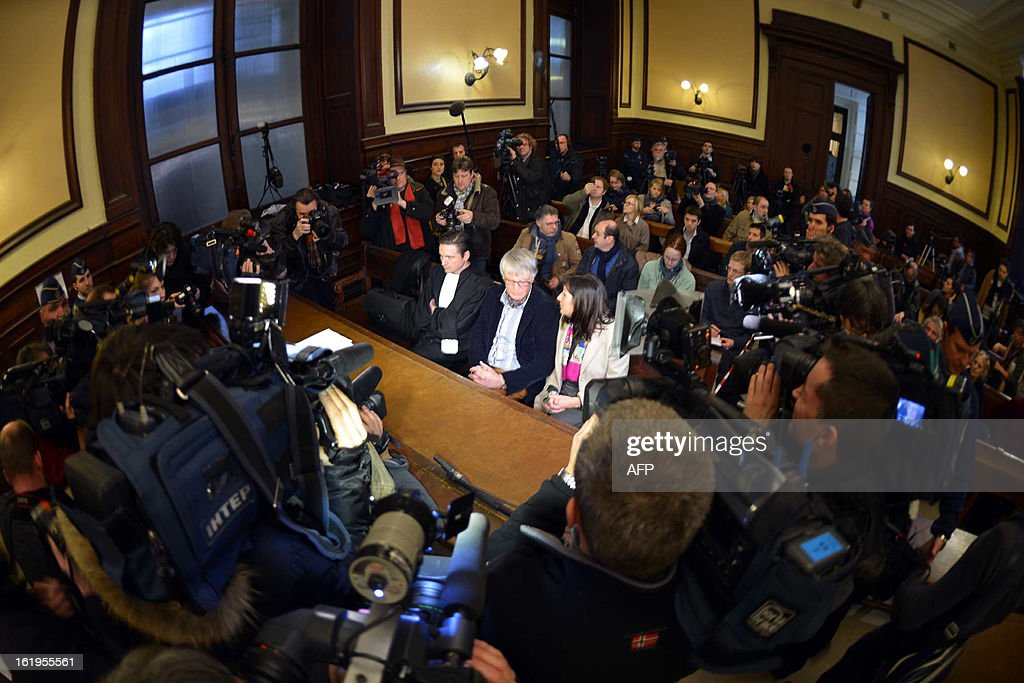 Journalists gather around Jean Lambrecks, (C), father of one of Marc Dutroux's victim Eefje after an appearance of notorious Belgian paedophile killer Marc Dutroux on February 18, 2013 at the courthouse in Brussels. A Belgian court on February 18 turned down a request by notorious child sex killer Marc Dutroux for early release from prison to serve out the rest of his sentence at home under electronic surveillance. The ruling against Belgium's 'most hated man,' cited the risk he might offend again after being jailed for life in 2004 for the kidnap and rape between June 1995 and August 1996 of six young and teenage girls, four of whom died.