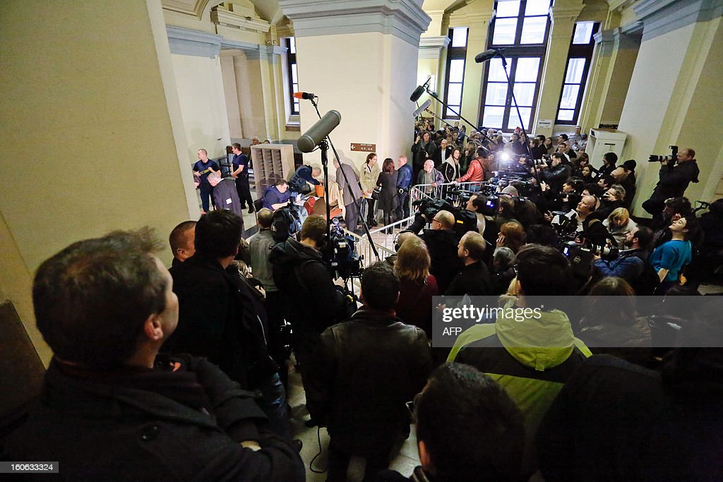 Journalists gather at the court in Brussels as Belgium's notorious serial child killer Marc Dutroux appeared before a special court seeking to be released and placed under house arrest with an electronic tag, in February 4, 2013. His appeal for early release comes just threee months before he completes 16 years of his life sentence for the kidnap and rape of six girls, and the murder of four of his victims, in one of the darkest episodes in Belgium's criminal history.
