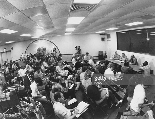 Journalists gather at the Press Center of the Kennedy Space Center in Florida for a briefing on the pending FRF a test burn on the main engines of...