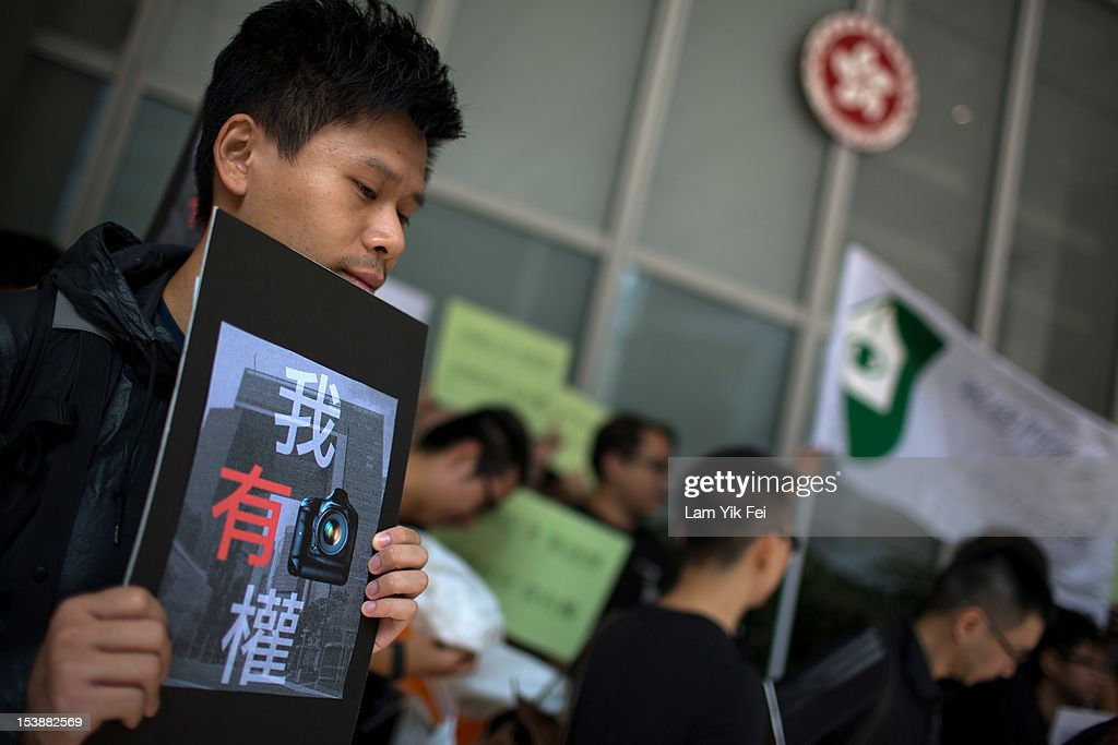 Journalists gather during a protest against the government of suppressing press freedom at the Central Government Complex on October 10, 2012 in Hong Kong. Former Apple Daily photographer Gary Sing Kai-chung was charged with assaulting a security guard while taking a picture of former education minister Michael Suen Ming-yeung.