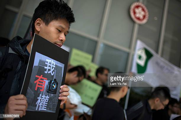 Journalists gather during a protest against the government of suppressing press freedom at the Central Government Complex on October 10 2012 in Hong...
