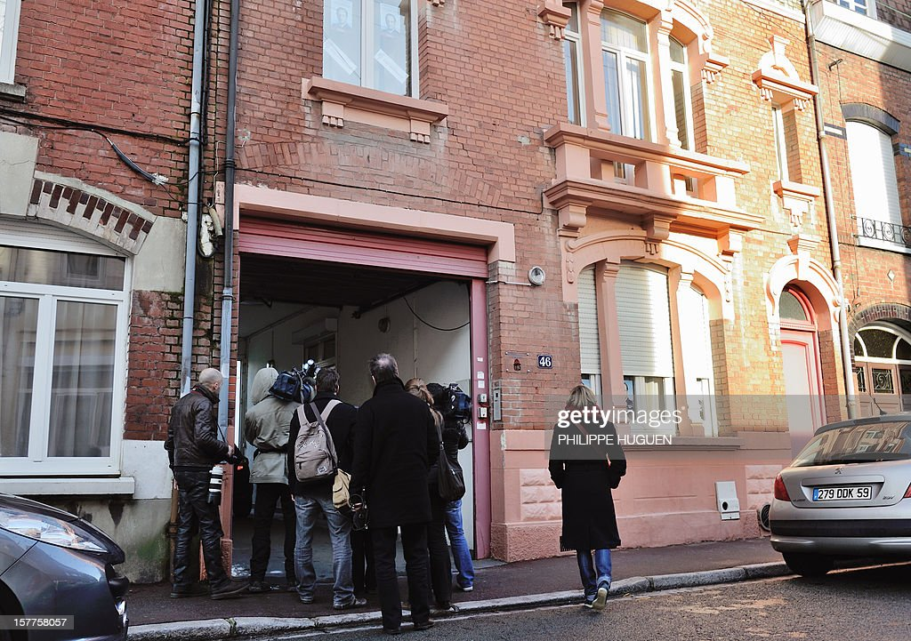 Journalists gather in front of the headquarters of the French socialist party federation of the Pas-de-Calais, on December 6, 2012 in Lens, during a search as part of an inquiry into an alleged hidden financing of this federation, involving local MP Jean-Pierre Kucheida.