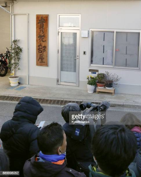 Journalists gather in front of the sumo stable run by Takanohana in Tokyo on Dec 11 2017 Police referred former sumo grand champion Harumafuji to...