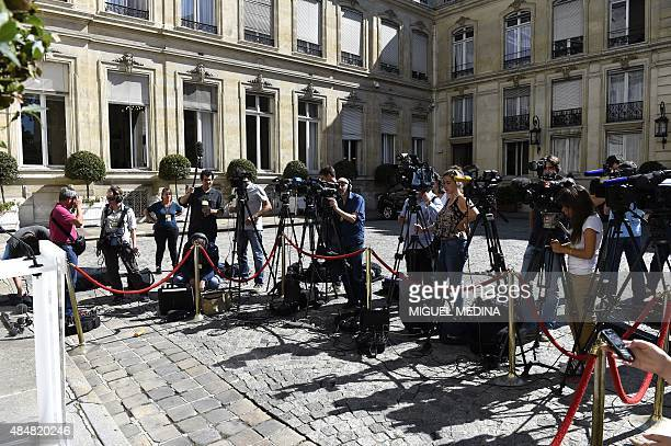 Journalists gather outside the Interior Ministry in the French capital Paris on August 22 2015 as they wait for a press conference by the Interior...