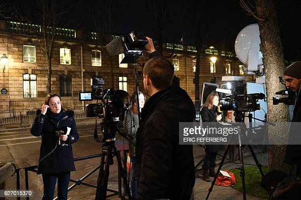 Journalists get ready during an official statement of French President Francois Hollande at the Elysee Palace in Paris on December 1 2016 France's...