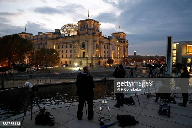 Journalists have their cameras trained on the building of the German Parliamentary Association where members of the delegations of the CDU/CSU...