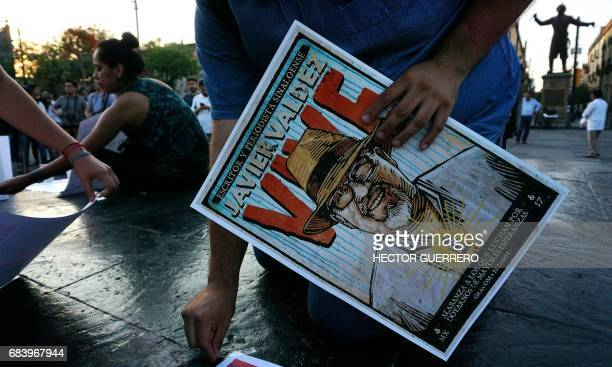 Journalists hold signs against violence to journalists while protesting the recent murder of the of Mexican journalist Javier Valdez on May 16 2017...