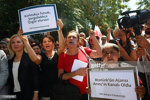 Journalists holding placards reading 'Ataturk's agency has become Arinc's channel' and 'When you afraid you became prisoner when you ask you will be...