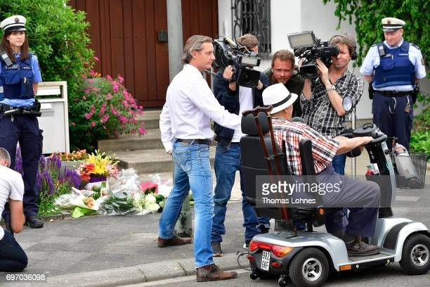Journalists interview a mourner outside the home of former German Chancellor Helmut Kohl in Oggersheim district on June 17 2017 in Ludwigshafen...
