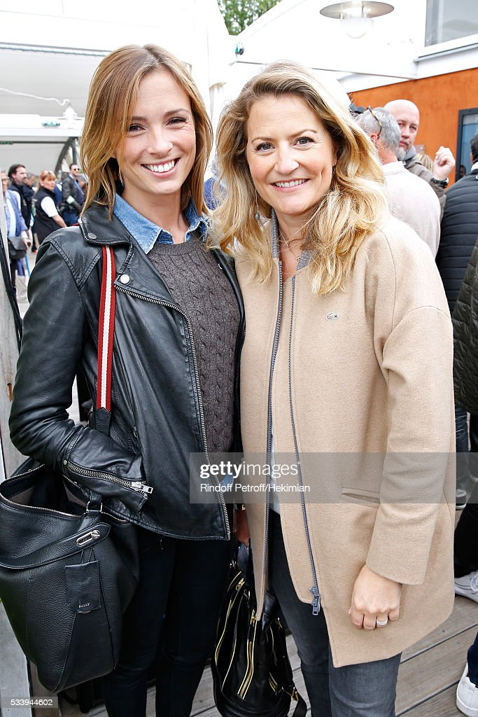 Journalists Isabelle Ithurburu and Astrid Bard attend the 2016 French Tennis Open - Day Three at Roland Garros on May 24, 2016 in Paris, France.