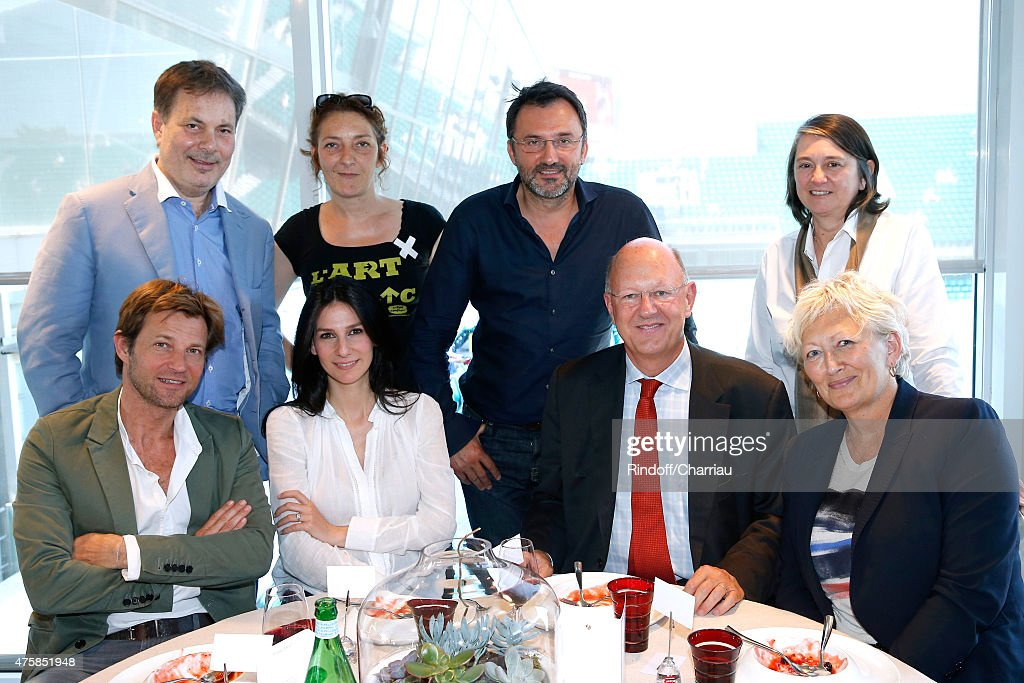 Journalists Laurent Delahousse, Marie Drucker, President of France Television Remy Pflimlin, Chairwoman of the Committee on Culture, Education and Communication, Senator Catherine Morin-Desailly, (Back L-R) Director Gabriel Aghion, Actress Corinne Masiero, TV Host Frederic Lopez and Producer Marie Masmonteil attend the 2015 Roland Garros French Tennis Open - Day Twelve, on June 4, 2015 in Paris, France.
