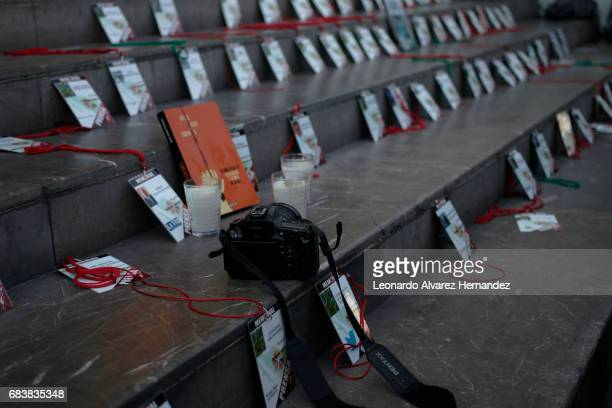Journalists lay out the credentials of their murdered colleagues during a demonstration after the Mexican journalist Javier Valdez murder at the...