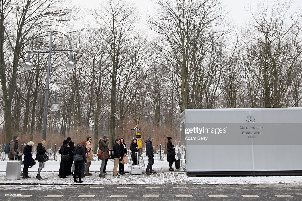 Journalists line up at the Press Accreditation container at Mercedes-Benz Fashion Week Autumn/Winter 2013/14 at The Brandenburg Gate on January 15, 2013 in Berlin, Germany.