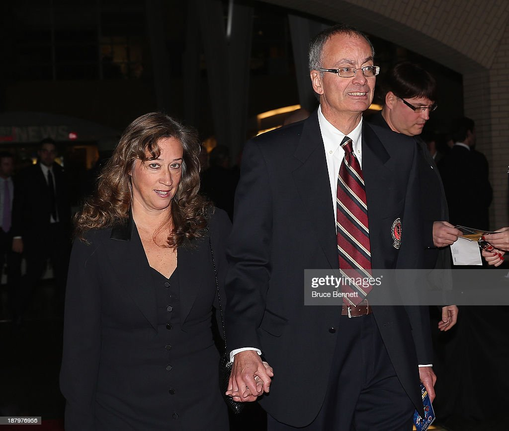 Journalists Lisa Dillman and Eric Duhatchek walk the red carpet prior to the 2013 Hockey Hall of Fame induction ceremony on November 11, 2013 in Toronto, Canada.