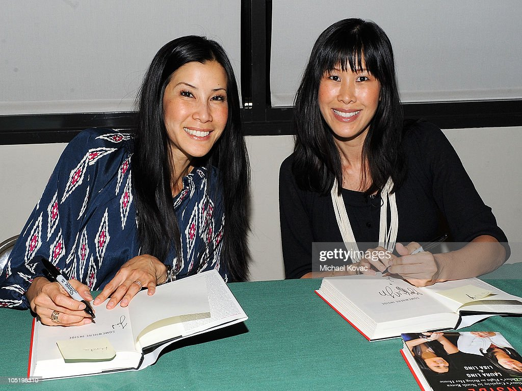 Journalists Lisa Ling and Laura Ling sign copies of their book 'Somewhere Inside' at the Whizin Center for Continuing Education at the American...