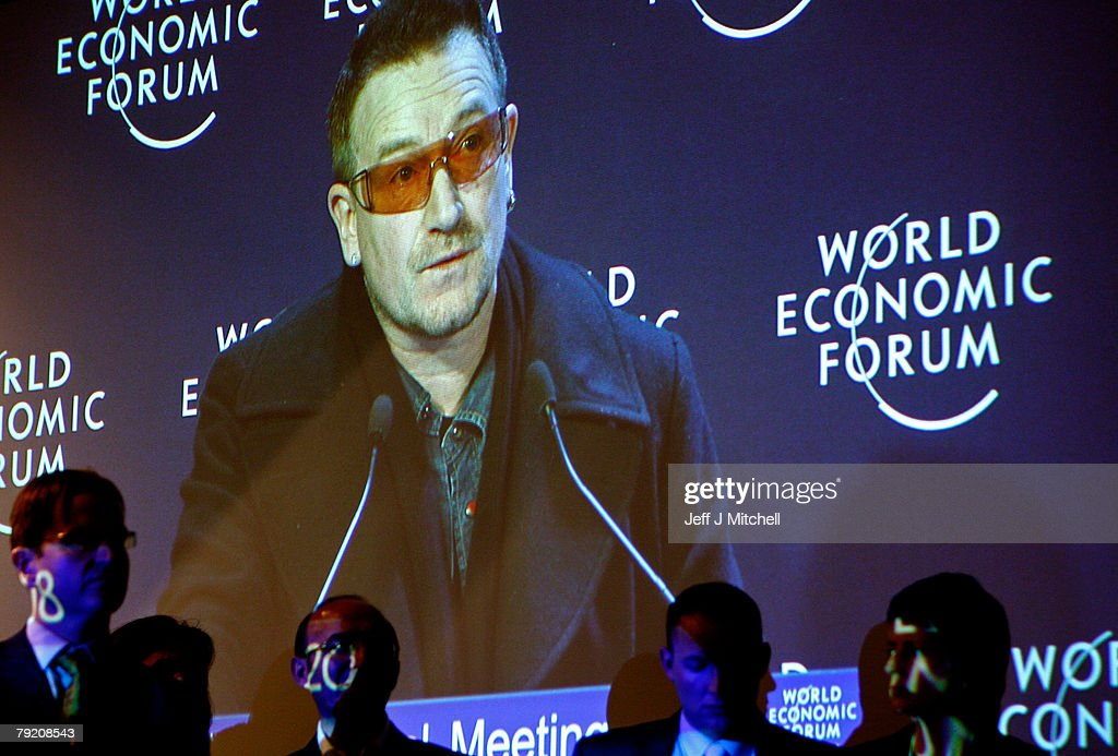 Journalists listen to Bono of the rock band U2 during the third day of the World Economic Forum January 25, 2008 in Davos, Switzerland. Some of the world's top business people, heads of state and representatives of NGOs will meet at the forum until Sunday.