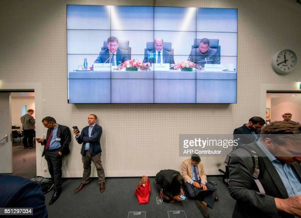 Journalists listen to OPEC ministers attending the OPEC meeting in Vienna Austria on September 22 2017 where the OPEC members reviewed progress on...